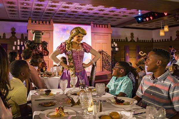 "Exclusive to the Disney Magic, Rapunzel's Royal Table is an all-new dining experience inspired by the beloved story of Disney's ""Tangled."" This dining experience features lively entertainment that transports Disney Magic guests to the kingdom of Corona for an evening of music, themed food offerings and interactive fun. (Matt Stroshane, photographer)"